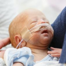 Little baby with oxyzen moustache