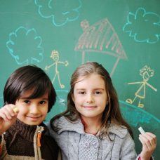 Children in front of chalkboard